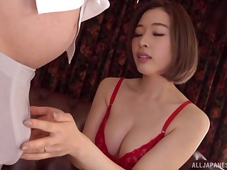 Japanese brunette MILF Honda Misaki takes off her bra and sucks cock
