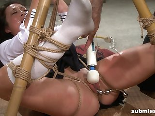 Teen in a miniskirt and socks Nyssa Nevers tied up and tortured
