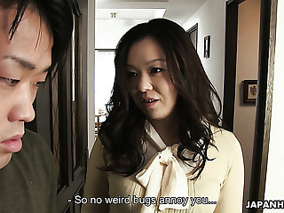 Brunette Asian milf blows dick of a nerdy young man for cumshot