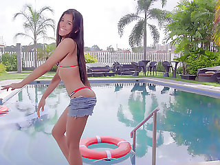 Karin Torres gets rid of her bikini and tickles pussy on inflatable mattress