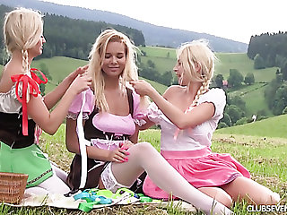 Three sexy girls in dirndl skirts enjoy picnic and outdoor masturbation